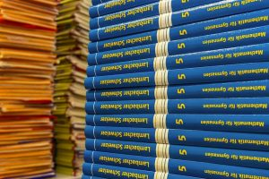 pile of A-level mathematicsbooks
